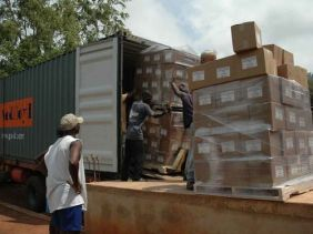 Unloading a container of Bibles