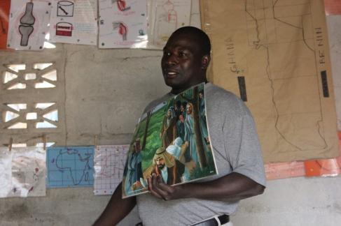 John the Kara school director teaching Bible