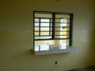 Serving window from kitchen to dining room
