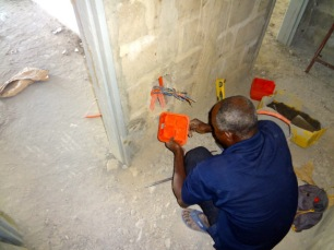 Adam, the electrician, works on the Children's Home