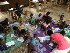 The younger group of children coloring