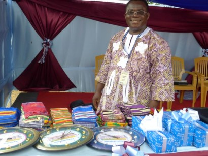 Pastor Joseph with gifts for workshop leaders and speakers