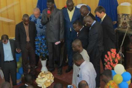 Pastor Leo praying for pastor Bernard and his wife