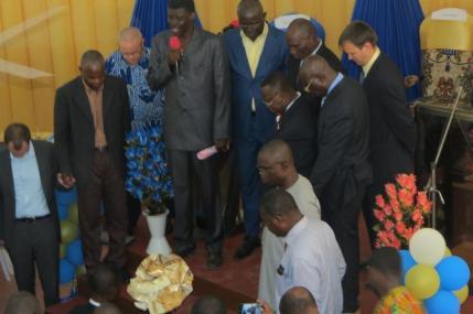Pastor Leo praying for pastor Bernard and his wife
