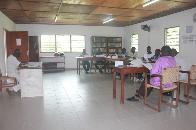 Pastor Happy teaching a class